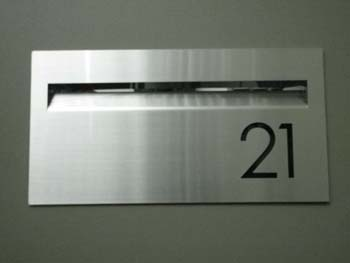Aussie Stainless Brick Pier letterbox with laser-cut numbers